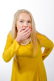Studio portrait of a blonde woman wearing yellow dress Royalty Free Stock Images