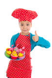 Studio portrait boy as little cook with cupcakes Royalty Free Stock Image