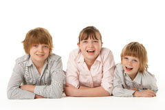 Studio Portrait Of Brothers And Sister Stock Photos