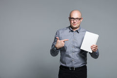 Studio portrait of business trainer holding the white book royalty free stock image