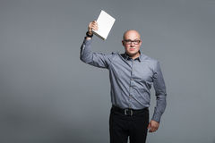 Studio portrait of business trainer holding the white book Royalty Free Stock Photos