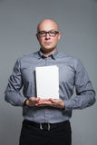 Studio portrait of business trainer holding the white book Royalty Free Stock Photo