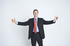 Studio Portrait Of Businessman With Arms Outstretched royalty free stock image