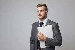Studio Portrait Of Businessman Holding Clipboard Stock Photography