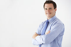 Studio Portrait Of Businessman Standing Against White Background Royalty Free Stock Image