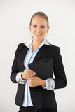 Studio Portrait Of Businesswoman Standing Against White Background Holding Digital Tablet Royalty Free Stock Images