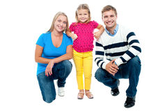 Studio portrait of charming young family Royalty Free Stock Images