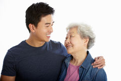 Studio Portrait Of Chinese Mother With Adult Son Royalty Free Stock Photography