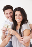 Studio Portrait Of Couple Celebrating With Champagne Stock Image