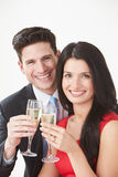 Studio Portrait Of Couple Celebrating With Champagne Royalty Free Stock Photos