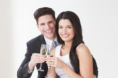 Studio Portrait Of Couple Celebrating With Champagne Royalty Free Stock Photo