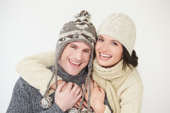 Studio Portrait Of Couple Wearing Warm Winter Clothes Royalty Free Stock Image