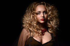 Studio portrait of curly blonde Royalty Free Stock Images