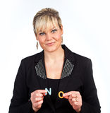Studio portrait of a cute blond girl holding two letters forming Stock Images