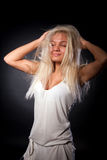 Studio portrait of cute girl playing with her hair Stock Images