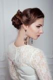 Studio portrait of elegant woman in white cocktail dress Royalty Free Stock Photo