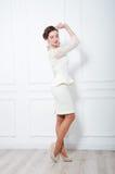 Studio portrait of elegant woman in white cocktail dress Royalty Free Stock Photos