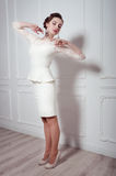 Studio portrait of elegant woman in white cocktail dress Stock Photos
