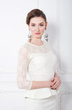 Studio portrait of elegant woman in white cocktail dress Royalty Free Stock Photography