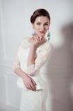 Studio portrait of elegant woman in white cocktail dress Stock Image
