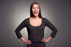 Studio portrait of excited woman. Over dark background Royalty Free Stock Photography
