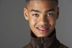 Studio Portrait Of Fashionably Dressed Teenage Boy Royalty Free Stock Images