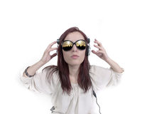 Studio portrait of a female DJ Royalty Free Stock Images