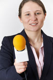Studio Portrait Of Female Journalist With Microphone royalty free stock photography