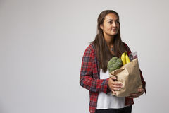 Studio Portrait Of Female Nutritionist With Bag Of Food royalty free stock images
