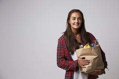 Studio Portrait Of Female Nutritionist With Bag Of Food Stock Photos