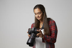 Studio Portrait Of Female Photographer With Camera royalty free stock images