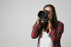 Studio Portrait Of Female Photographer With Camera royalty free stock image