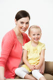 Studio Portrait Of Female Pre School Teacher With Pupil. Smiling To Camera Stock Images