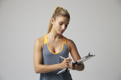 Studio Portrait Of Female Sports Coach With Clipboard Stock Photography