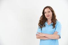 Studio Portrait Of Female Staff Member Wearing Uniform Against W Stock Images