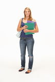Studio Portrait Of Female Student Holding Folders Stock Photography