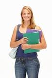 Studio Portrait Of Female Student Holding Folders Stock Photo