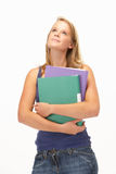 Studio Portrait Of Female Student Holding Folders Royalty Free Stock Photography