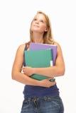 Studio Portrait Of Female Student Holding Folders Royalty Free Stock Photography