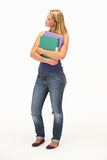 Studio Portrait Of Female Student Holding Folders Royalty Free Stock Images