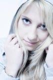 Studio portrait of friendly looking a long blond g stock photo