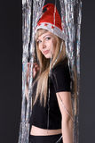 Studio portrait of a girl in a hat of Santa Claus Stock Image