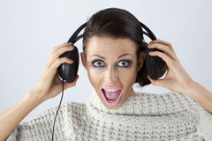 Studio portrait of a girl in headphones Royalty Free Stock Photo