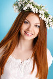 Studio portrait of a girl in wreath of flowers Royalty Free Stock Photos