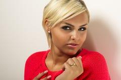 Studio portrait of a glamorous blond Stock Image