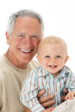 Studio Portrait Of Grandfather Holding Grandson Royalty Free Stock Images