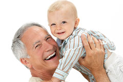 Studio Portrait Of Grandfather Holding Grandson Stock Photo