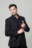 Studio portrait of handsome elegant young man in black clothes Royalty Free Stock Photos