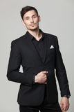 Studio portrait of handsome elegant young man in black clothes Royalty Free Stock Image