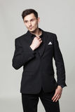 Studio portrait of handsome elegant young man in black clothes Stock Images